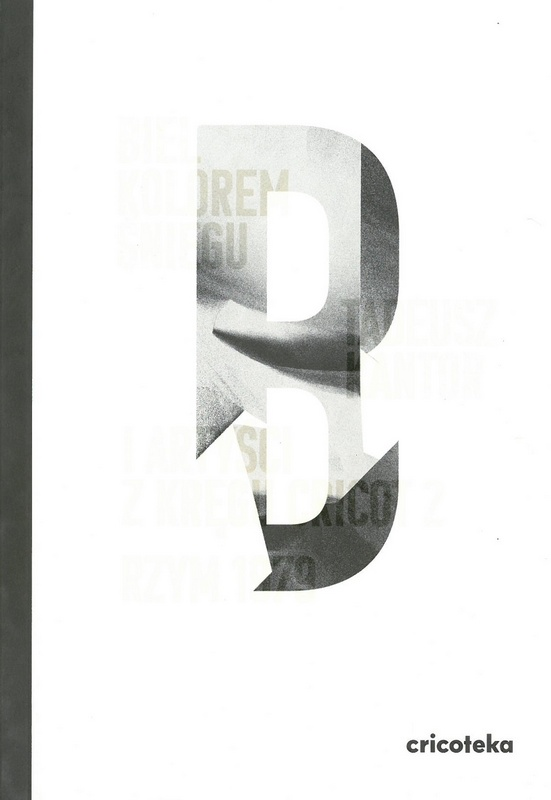 Biała okładka z szarą literą B