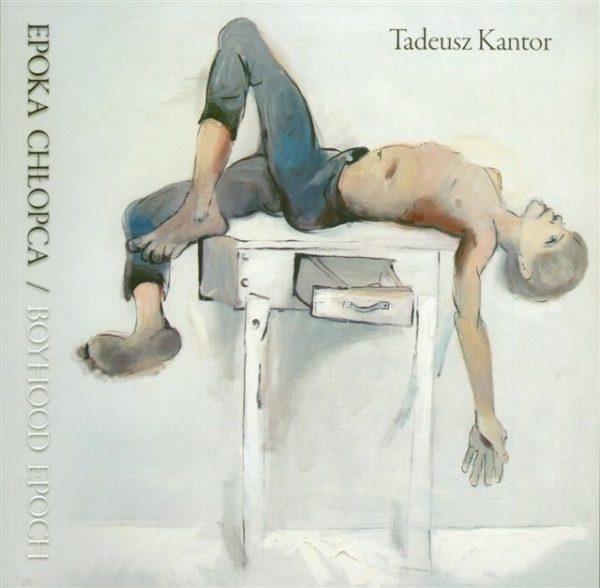 Okładka z rysunkiem chłopca leżącego na biurku